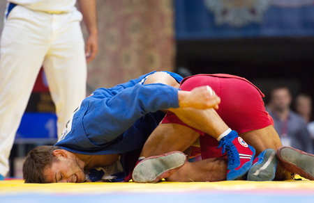 RUSSIA, MOSCOW - MARCH 27: Emil Khasanov (R) and Evgeniy Sukhomlinov (B) fights on World Sambo Championship Kharlampiev memorial in Luzhniki sport palace, Moscow, Russia, 2015