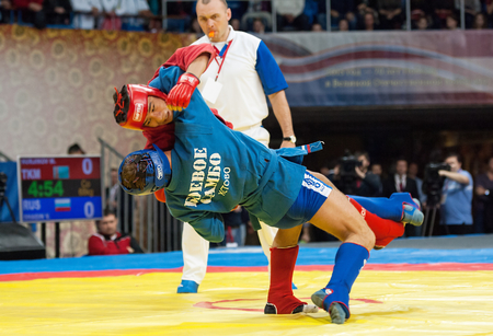 sambo: RUSSIA, MOSCOW - MARCH 27: Mekan Nurjikov (R) vs Vadim Shagin (B) on World Sambo Championship Kharlampiev memorial in Luzhniki sport palace, Moscow, Russia, 2015 Editorial