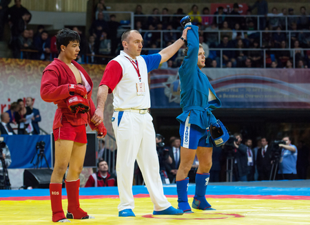 RUSSIA, MOSCOW - MARCH 27: Winer Vadim Shagin (B) and Mekan Nurjikov (R) on World Sambo Championship Kharlampiev memorial in Luzhniki sport palace, Moscow, Russia, 2015