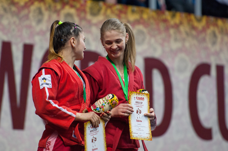 RUSSIA, MOSCOW - MARCH 27: Third place winners N. Zaitseva (R) and D. Khondiu (L) on World Sambo Championship Kharlampiev memorial in Luzhniki sport palace, Moscow, Russia, 2015