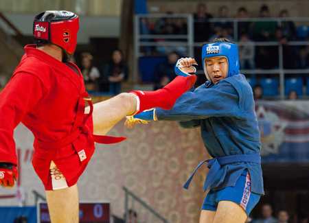 sambo: RUSSIA, MOSCOW - MARCH 27: Ikram Aliskerov (R) vs Jeon Yong jun (B) on World Sambo Championship Kharlampiev memorial in Luzhniki sport palace, Moscow, Russia, 2015 Editorial