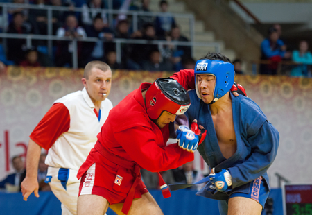 RUSSIA, MOSCOW - MARCH 27: Ikram Aliskerov (R) and Jeon Yong jun (B) fights on World Sambo Championship Kharlampiev memorial in Luzhniki sport palace, Moscow, Russia, 2015
