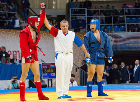 sambo: RUSSIA, MOSCOW - MARCH 27: Winner Ikram Aliskerov (R) vs Jeon Yong jun (B) on World Sambo Championship Kharlampiev memorial in Luzhniki sport palace, Moscow, Russia, 2015