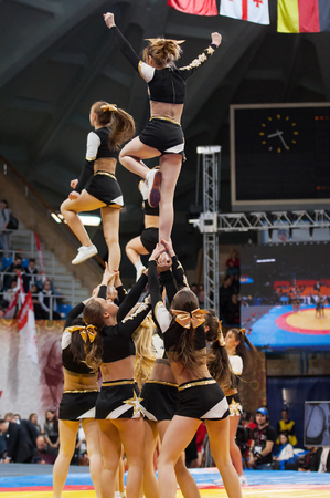 sambo: RUSSIA, MOSCOW - MARCH 27: Unidentified cheerleaders show the  acrobatic jump on World Sambo Championship Kharlampiev memorial in Luzhniki sport palace, Moscow, Russia, 2015 Editorial