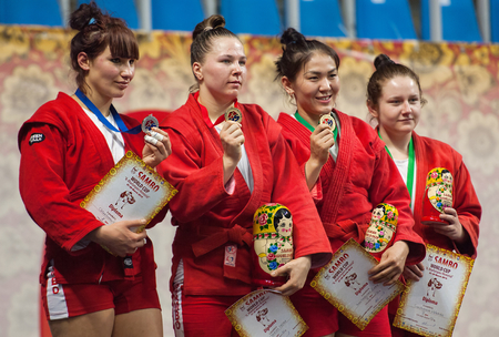 sambo: RUSSIA, MOSCOW - MARCH 27: Unidentified awardees on podium on World Sambo Championship Kharlampiev memorial in Luzhniki sport palace, Moscow, Russia, 2015