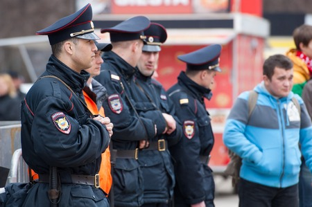 RUSSIA MOSCOW  APRIL 18: Unidentified police men secure on event of 80th anniversary of Spartak team in Luzhniki Moscow Russia 2015