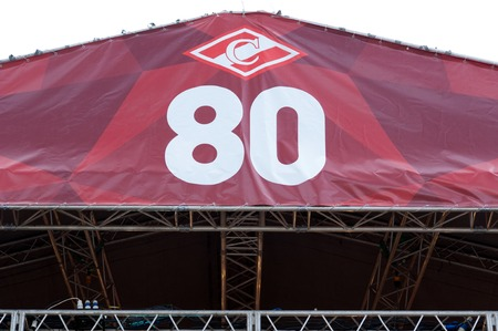 spartak: RUSSIA MOSCOW  APRIL 18: Billboard with a sign on event of 80th anniversary of Spartak team in Luzhniki Moscow Russia 2015 Editorial