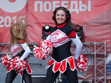 spartak: RUSSIA MOSCOW APRIL 18: Unidentified Cheerleaders of Spartak team dancing during on event of 80th anniversary of Spartak team in Luzhniki Moscow Russia 2015