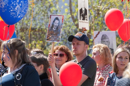 immortal: RUSSIA ROSTOV CITY  MAY 9: Unidentified hold a hero portrait on Victory day parade dedicated 70 anniversary of WWII end on May 9 2015 in Yaroslavl region Rostov the Great city Russia Editorial