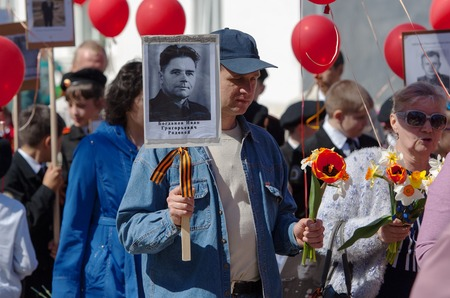 immortal: RUSSIA ROSTOV CITY  MAY 9: Unidentified man walk on Victory day parade dedicated 70 anniversary of WWII end on May 9 2015 in Yaroslavl region Rostov the Great city Russia