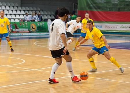 diaspora: MOSCOW - DECEMBER 13: Unidentified players of Turkish diaspora team with ball on Minifootball tournament in memoriam Tofik Bahramov on  December 13, 2014, in Krilatskoe stadium, Moscow, Russia