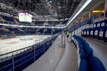 helmet seat: RUSSIA, MOSCOW - APRIL 27, 2015: Interior of Ice Palace VTB Moscow just before hockey game CSKA vs SKA teams on Hockey Cup of Legends in Ice Palace VTB, Moscow, Russia