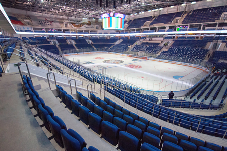 ice hockey: RUSSIA, MOSCOW - APRIL 27, 2015: Spectators seats row just before hockey game CSKA vs SKA teams on Hockey Cup of Legends in Ice Palace VTB, Moscow, Russia