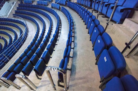 legends: RUSSIA, MOSCOW - APRIL 27, 2015: Numbered seats row just before hockey game CSKA vs SKA teams on Hockey Cup of Legends in Ice Palace VTB, Moscow, Russia
