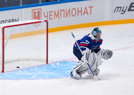 legend: RUSSIA, MOSCOW - APRIL 27, 2015: Maxim Sokolov 39, goaltender of SKA Legend team on hockey game CSKA vs SKA teams on Hockey Cup of Legends in Ice Palace VTB, Moscow, Russia Editorial