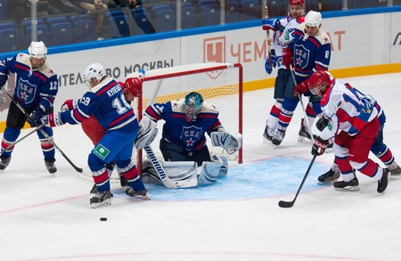defend: RUSSIA, MOSCOW - APRIL 27, 2015: A. Kuleshov 19 and D. Chervyakov 8 defend the gate on hockey game CSKA vs SKA teams on Hockey Cup of Legends in Ice Palace VTB, Moscow, Russia