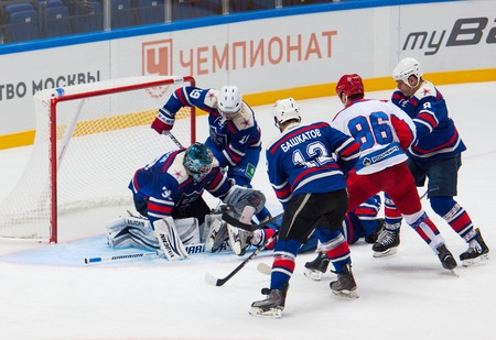 defend: RUSSIA, MOSCOW - APRIL 27, 2015: A. Kuleshov 19 defend the gate on hockey game CSKA vs SKA teams on Hockey Cup of Legends in Ice Palace VTB, Moscow, Russia