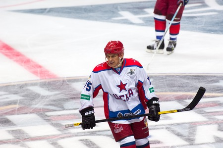 legends: RUSSIA, MOSCOW - APRIL 27, 2015: Andrey Kvartalnov 75 in action on hockey game CSKA vs SKA teams on Hockey Cup of Legends in Ice Palace VTB, Moscow, Russia