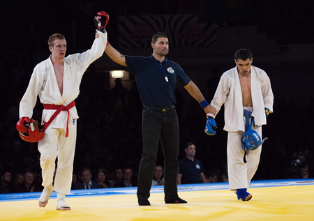 RUSSIA, MOSCOW - APRIL 18 2015: Makarov V. (Red), winner, and Mukashev U. (Blue) on World Hand to hand combat Championship in Moscow, Russia, 2015 Editorial