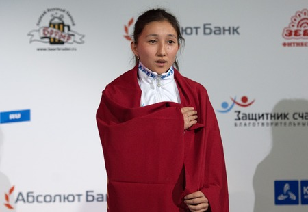 medalist: RUSSIA, MOSCOW - APRIL 18 2015: Albina Mambetova, gold medalist, winner of the World Hand to hand combat Championship in Moscow, Russia, 2015 Editorial