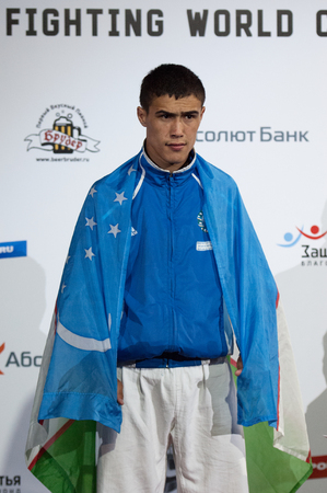 medalist: RUSSIA, MOSCOW - APRIL 18 2015: Shakboz Tursunov, gold medalist, winner of the Third World Hand to hand combat Championship in Moscow, Russia, 2015