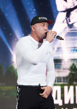 RUSSIA, MOSCOW - APRIL 18 2015: Hip-Hop singer Seryoga Sergey Parhomenko sing a song on World Hand to hand combat Championship in Moscow, Russia, 2015 Editorial