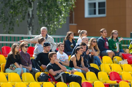 spectators: RUSSIA, TROITSK CITY - JULY 11: Spectators on tribunes during Russian american football Championship game Spartans vs Raiders 52 on July 11, 2015, in Moscow region, Troitsk city, Russia Editorial