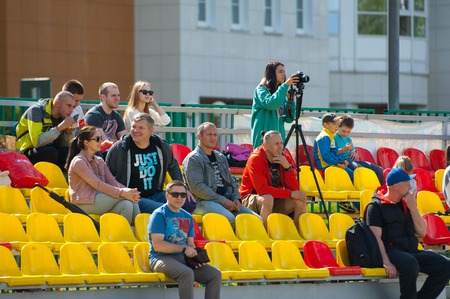 spectators: RUSSIA, TROITSK CITY - JULY 11:  Spectators on tribunes during Russian american football Championship game Spartans vs Raiders 52 on July 11, 2015, in Moscow region, Troitsk city, Russia