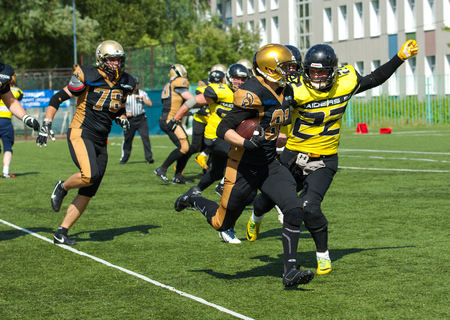 81: RUSSIA, TROITSK CITY - JULY 11:  A. Podyapolsky (81) run with ball on Russian american football Championship game Spartans vs Raiders 52 on July 11, 2015, in Moscow region, Troitsk city, Russia
