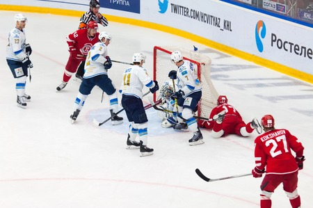 defend: MOSCOW - OCTOBER 17, 2015: A. Ivanov 28 and D. Boyd 41 defend the gate during hockey game Vityaz vs Barys on Russia KHL championship on October 17, 2015, in Moscow, Russia. Vityaz won 4:3