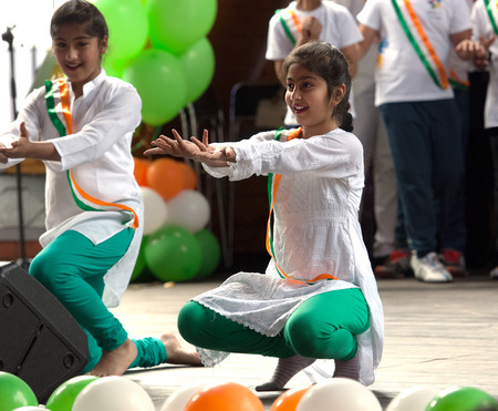 independence day: RUSSIA, MOSCOW - AUGUST 16, 2015: Unidentified teens of Hendustani folk collective dance on a scene on Independence Day of India in Sokolniki park, Moscow, Russia Editorial