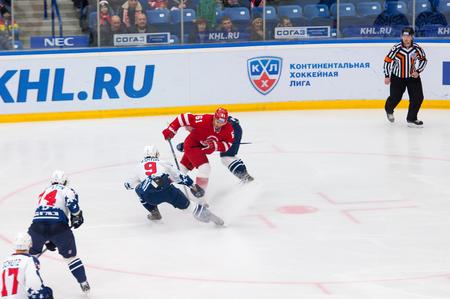 k 9: PODOLSK - NOVEMBER 21, 2015: K. Ashton 9 versus M. Afinogenov 61 on hockey game Vityaz vs Torpedo on Russia KHL championship in Vutyaz ice arena, Podolsk, Russia. Torpedo won 4:3