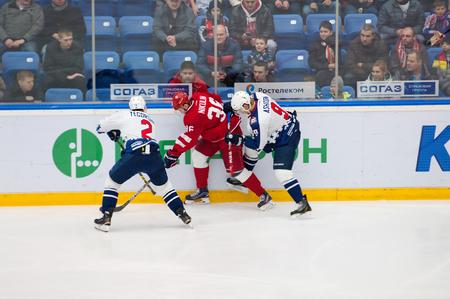 k 9: PODOLSK - NOVEMBER 21, 2015: S. Yegorshev 2, A. Nikulin 36 and K. Ashton 9 during hockey game Vityaz vs Torpedo on Russia KHL championship in Vutyaz ice arena, Podolsk, Russia. Torpedo won 4:3