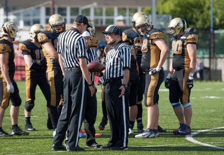 referees: RUSSIA, TROITSK CITY - JULY 11: Unidentified referees arguing on Russian american football Championship game Spartans vs Raiders 52 on July 11, 2015, in Moscow region, Troitsk city, Russia Editorial