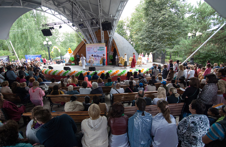 interrior: RUSSIA, MOSCOW - AUGUST 16, 2015: Unidentified spectators on tribunes watch a performance dedicated to Independence Day of India in Sokolniki park, Moscow, Russia
