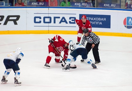 MOSCOW - OCTOBER 17, 2015: R. Horak 15 and T. Eronen 4 on faceoff during hockey game Vityaz vs Barys on Russia KHL championship on October 17, 2015, in Moscow, Russia. Vityaz won 4:3 Editorial