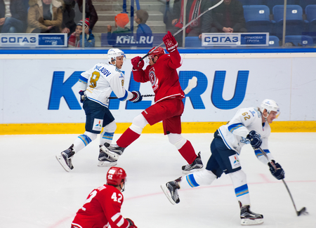 face off: MOSCOW - OCTOBER 17, 2015: D. Eghov 5 versus T. Zhailauov 8 during hockey game Vityaz vs Barys on Russia KHL championship on October 17, 2015, in Moscow, Russia. Vityaz won 4:3