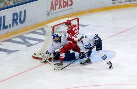 spartak: MOSCOW - JANUARY 15: Vyacheslav Leshchenko (27) attack during hockey game Spartak vs Admiral on Russian KHL premier hockey league Championship on January 15, 2016, in Moscow, Russia. Spartak won 5:4