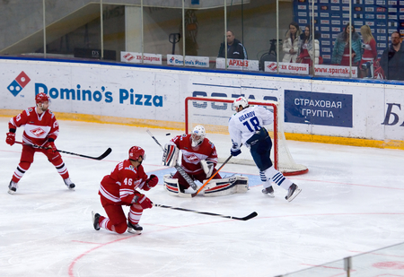 15 18: MOSCOW - JANUARY 15:  A. Ugarov (18) attack, E, Ivannikov (31) defend during hockey game Spartak vs Admiral on Russian KHL premier hockey league Championship on January 15, 2016, in Moscow, Russia. Spartak won 5:4
