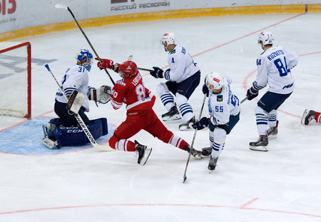 spartak: MOSCOW - JANUARY 15: Igor Levitsky (80) attack and fall during hockey game Spartak vs Admiral on Russian KHL premier hockey league Championship on January 15, 2016, in Moscow, Russia. Spartak won 5:4