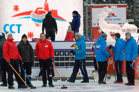 rus: MOSCOW - JANUARY 17, 2016: Sportsmen of Michel (Switz) and Dmitrov (Rus) teams just before Russian Curling Champions Tour Moscow Classic 2016 on January 17, in Moscow, Russia, 2016 Editorial