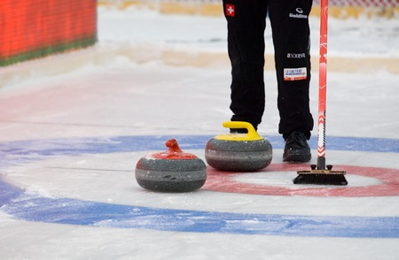 calibrate: MOSCOW - JANUARY 17, 2016: Unidentified player stand by curling target on Russian Curling Champions Tour Moscow Classic 2016 on January 17, in Moscow, Russia, 2016