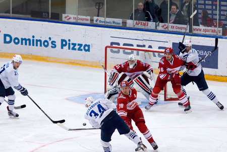 spartak: MOSCOW - JANUARY 15: V. Alexandrov (34) attack during hockey game Spartak vs Admiral on Russian KHL premier hockey league Championship on January 15, 2016, in Moscow, Russia. Spartak won 5:4