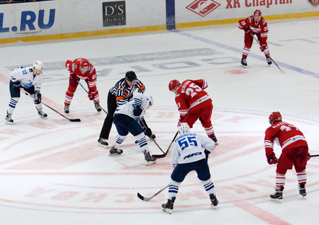 spartak: MOSCOW - JANUARY 15: A. Mereskin (25) on faceoff during hockey game Spartak vs Admiral on Russian KHL premier hockey league Championship on January 15, 2016, in Moscow, Russia. Spartak won 5:4