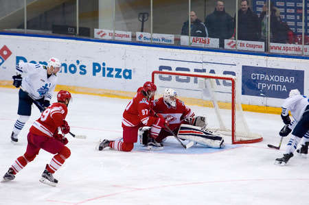 spartak: MOSCOW - JANUARY 15: Matthew Gilroy (97) defend during hockey game Spartak vs Admiral on Russian KHL premier hockey league Championship on January 15, 2016, in Moscow, Russia. Spartak won 5:4
