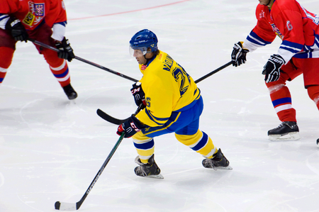 dribbling: MOSCOW - JANUARY 29, 2016: Mats Naslund (26) dribbling during hockey game Sweden vs Czech on League of World legends of Ice hockey championship in VTB ice arena, Russia. Czech won 8:2