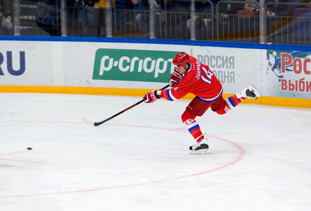 legends: MOSCOW - JANUARY 29, 2016: A. Zhamnov (14) attack on hockey game Finland vs Russia on League of World legends of Ice hockey championship in VTB ice arena, Russia. Russia won 6:2