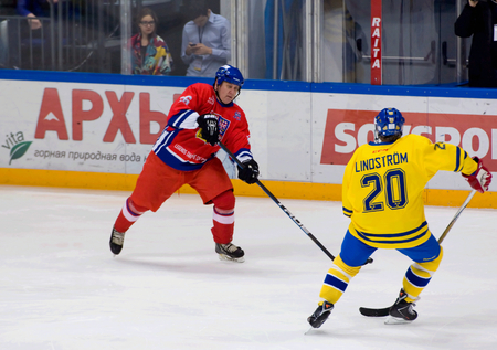 willy: MOSCOW - JANUARY 29, 2016: Jiri Krasny (26) and Willy Lindstrom (20) in action during hockey game Sweden vs Czech on League of World legends of Ice hockey championship in VTB ice arena, Russia. Czech won 8:2