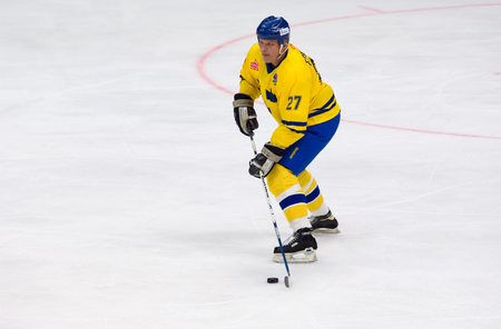 ericsson: MOSCOW - JANUARY 29, 2016: Thomas Eriksson (27) dribble during hockey game Sweden vs Czech on League of World legends of Ice hockey championship in VTB ice arena, Russia. Czech won 8:2 Editorial