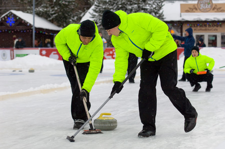 MOSCOW - JANUARY 17, 2016: Unidentified players of Russia-2 team in action during Russian Curling Champions Tour Moscow Classic 2016 on January 17, in Moscow, Russia, 2016